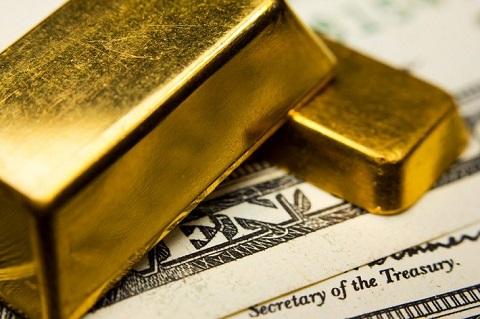 Đồng dollar mạnh buộc vàng thoái lui trong phiên Á